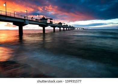Sunset over Baltic Sea and pier in Miedzyzdroje, Poland, Europe