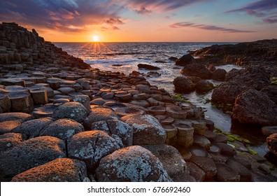 sunset over basalt columns Giant's Causeway known as UNESCO World Heritage Site, County Antrim, Northern Ireland