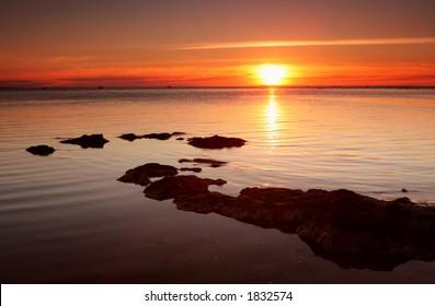 Sunset over bay beach, Melbourne, Australia