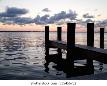 Sunset Over Bay with Silhouette of Dock