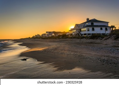 Sunset over beachfront homes at Edisto Beach, South Carolina.