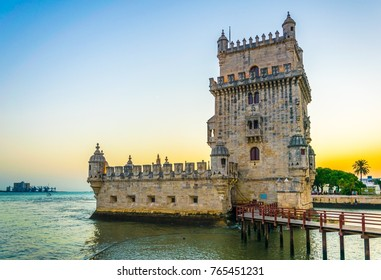 Sunset over belem tower in lisbon