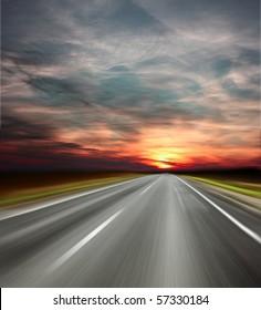 Sunset over blurred asphalt road