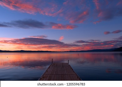 Sunset over a boat dock on a lake