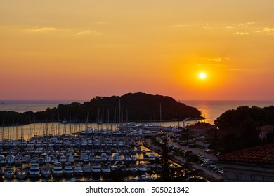 Sunset over the boat harbor of Vrsar