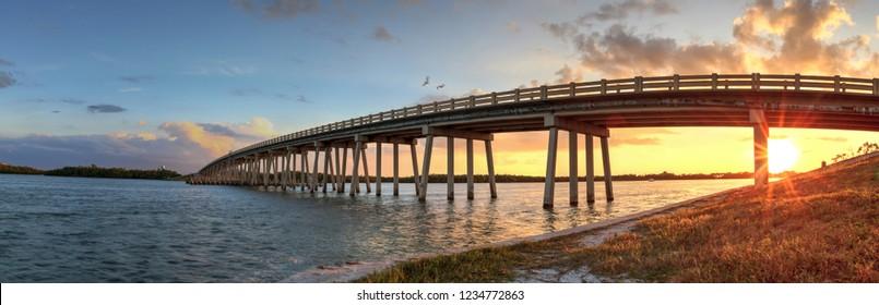 Sunset over Bridge along Estero Boulevard, crossing over New Pass from Estero Bay in Bonita Springs, Florida.