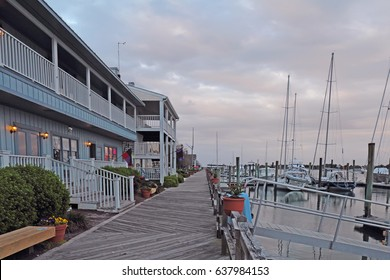 Sunset over buildings, boats and the docks on Taylor Creek off of Front Street in Beaufort, the third-oldest town in North Carolina