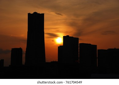 sunset over the buildings of Minato Mirai district in Yokohama, Japan