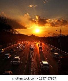 Sunset over a busy high-speed road