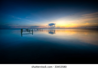 Sunset over calm Caribbean waters in Rock Sound, Eleuthera.