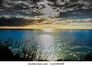 Sunset over the calm ocean waters
