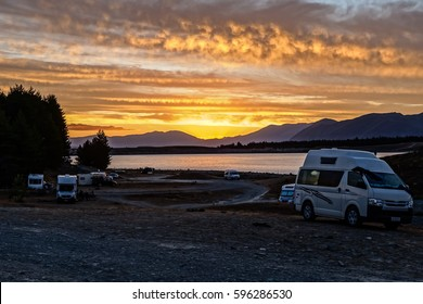 Sunset over Campervans and lake