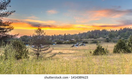 Sunset over camping ground on plateau of the Causse Noir in Cevennes National park, Occitanie, France