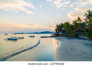 Sunset over the Candidasa beach, Candidasa, Bali, Indonesia