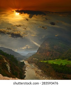 sunset over the canyon mountain river in the Himalayas. Uttarakhand, India