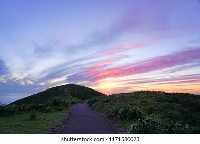 Sunset over Cape Reinga (Te Rerenga Wairua), the northwesternmost tip of the Aupouri Peninsula, at the northern end of the North Island of New Zealand, where the Tasman Sea meets the Pacific Ocean