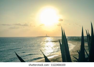 Sunset over the Cape Trafalgar lighthouse, in Cadiz, Spain