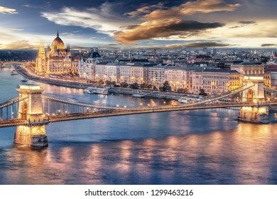 Sunset over the capital city of Hungary, Budapest. Aerial view with the Danube river, Chain Bridge and the Parliament building.