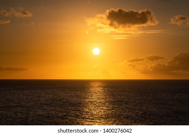 Sunset over the Caribbean Sea. Beautiful Golden Sky with clouds