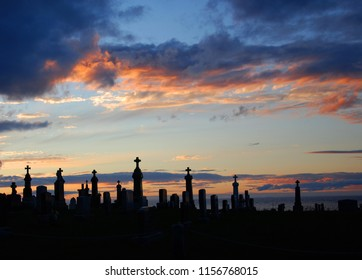 Sunset over cemetery Gaspesie Quebec Canada