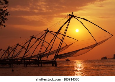 Sunset over Chinese Fishing nets in Cochin (Kochi), Kerala, India.