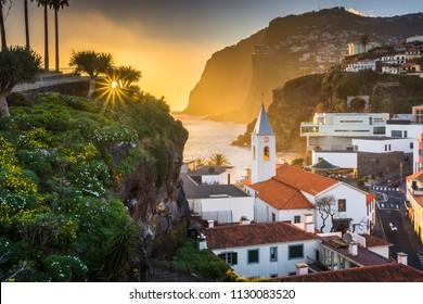 Sunset over the church in Camara de Lobos, Madeira, Portugal