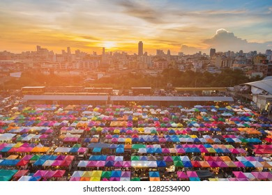 Sunset over city flea market aerial view, Bangkok cityscape downtown