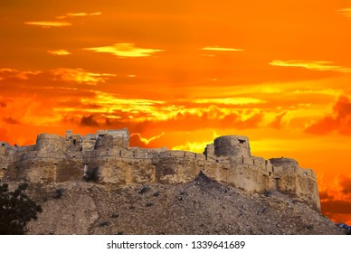 Sunset over city fortress walls of Jaisalmer, India