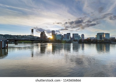 Sunset over the City of Portland Oregon downtown waterfront by Hawthorne Bridge along Willamette River