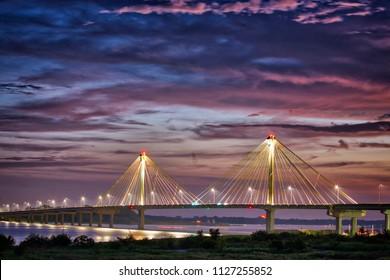 Sunset over Clark Bridge on Mississippi river Alton, IL