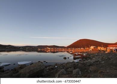Sunset over the community of Qikiqtarjuaq on Broughton Island, Nunavut, Canada