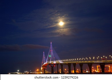 sunset over the Constitution Bridge, called La Pepa, in the bay of Cádiz, Andalusia. Spain. Europe