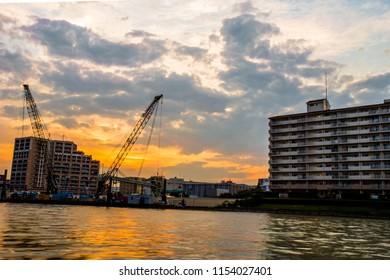 Sunset over construction by the Sumida River, Tokyo
