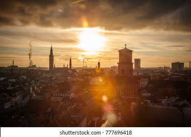 Sunset over Copenhagen cityscape. View with sunlight and lense effects. Romantic atmosphere. The capital and most populous city of Denmark. A popular place for tourists and traveler.