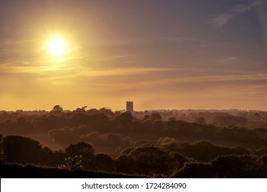 Sunset over the countryside in Suffolk, England with Lavenham´s church tower in the background