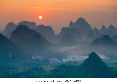 Sunset over Cuiping Wuzhi Hill in Guilin, China