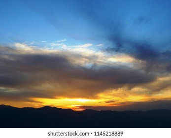 The sunset over Dante's View. Dante's View is a viewpoint terrace at 1,669 m, on the north side of Coffin Peak, along the crest of Black Mountains, overlooking Death Valley, California (USA).