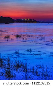 Sunset over Danube river in Belgrade, Serbia, with Zemun in the distance