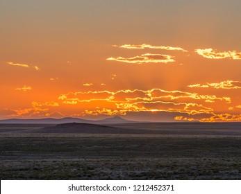 Sunset over the desert horizon