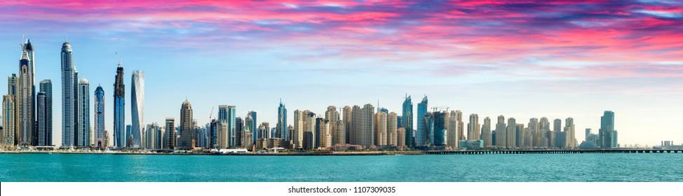 Sunset over Dubai Marina skyscrapers, United Emirates.