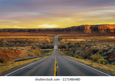 Sunset over an empty road in Utah near its border with Arizona, USA