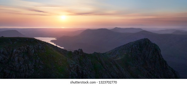 Sunset over Ennerdale Water from Scoat Fell, Steeple In the English Lake District, UK.
