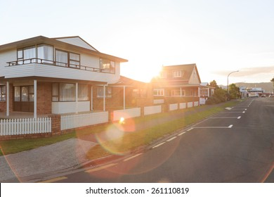 Sunset over family homes in a suburban area in Whitianga, New Zealand