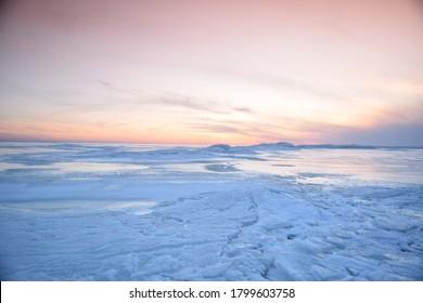 Sunset over the Finnish Gulf, winter, sun and ice