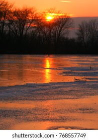 Sunset over frozen backwaters of the Kishwaukee River in northern Illinois