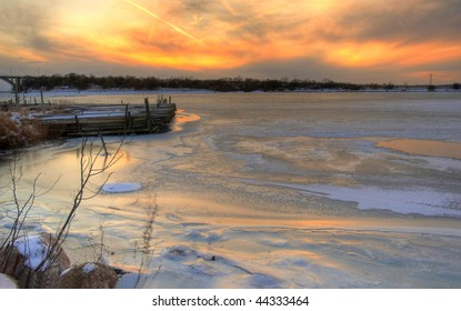 Sunset over the frozen Baltic Sea at Ulfsund in Denmark