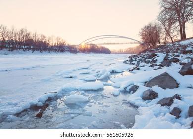 Sunset over frozen Tisza river
