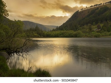 Sunset over Glendalough lower lake, ireland