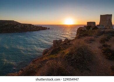 Sunset over Gnejna Bay and Ghajn Tuffieha Tower, Malta