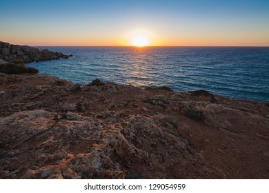 Sunset over Gnejna Bay, west side of the island, Malta